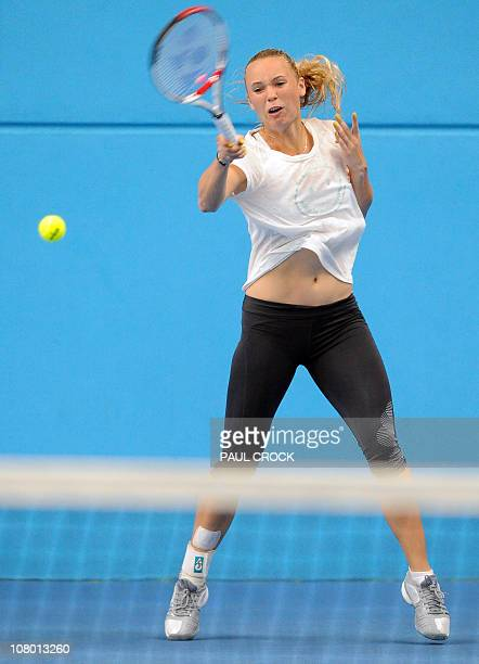 Tennis world number one Caroline Wozniaki of Denmark plays a shot during a practice session for the upcoming Australian Open tennis tournament in...