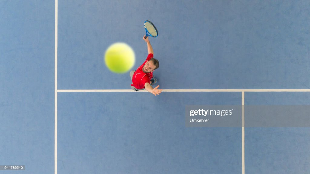 Tennisplayer from above : Stock Photo
