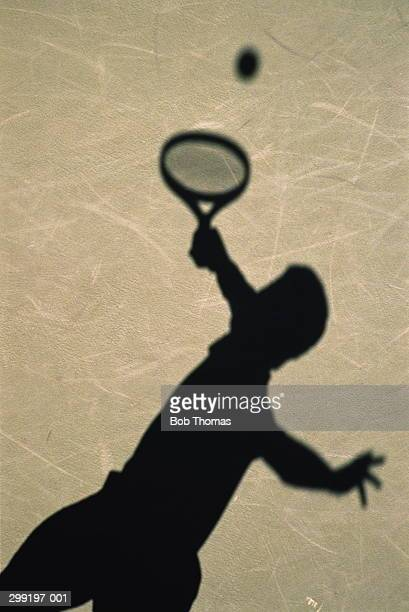 Tennis,shadow of player serving