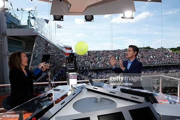 Tenniswoman Justine Henin and Sports Journalist Laurent Luyat attend the French Tennis Open 2015 at Roland Garros on May 30, 2015 in Paris, France.