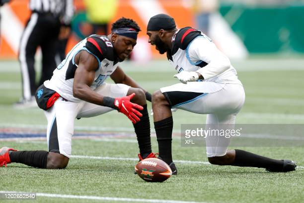 Tenny Adewusi of the Dallas Renegades left with teammate Josh Hawkins of the Dallas Renegades celebrating on the field during the XFL game at...