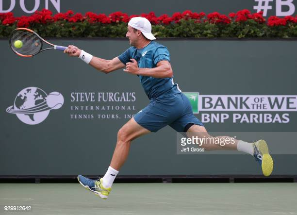 Tennys Sandgren lunges to return a forehand to Nikoloz Basilashvili of Georgia during the BNP Paribas Open at the Indian Wells Tennis Garden on March...