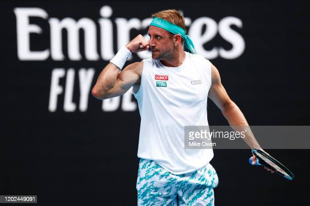 Tennys Sandgren of the United States celebrates after winning a point during his Men's Singles Quarterfinal match against Roger Federer of...