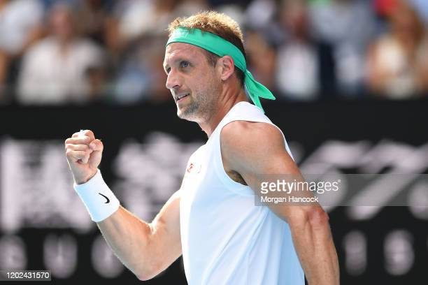 Tennys Sandgren of the United States celebrates after winning the third set during his Men's Singles Quarterfinal match against Roger Federer of...