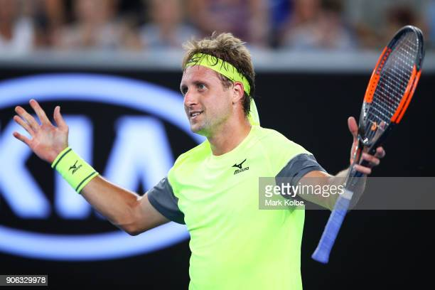 Tennys Sandgren of the United States celebrates match point in his second round match against Stan Wawrinka of Switzerland on day four of the 2018...