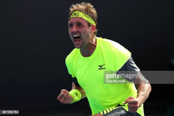 Tennys Sandgren of the United States celebrates winning match point in his third round match against Maximilian Marterer of Germany on day six of the...