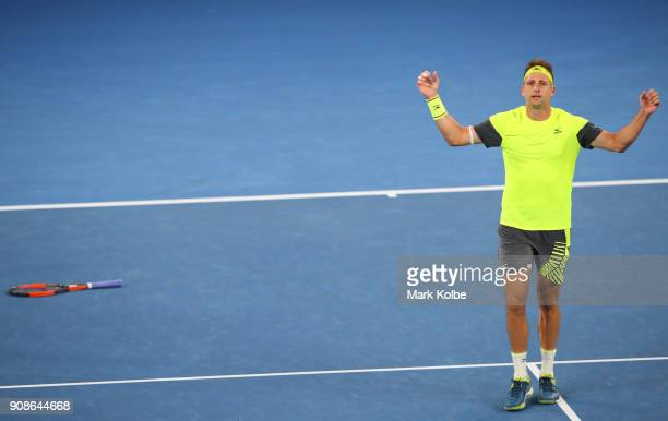 Tennys Sandgren of the United States celebrates winning match point in his fourth round match against Dominic Thiem of Austria on day eight of the...