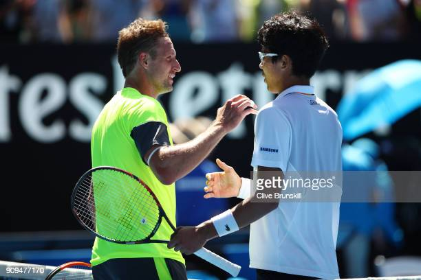 Tennys Sandgren of the United States congratulates Hyeon Chung of South Korea after Chung won their quarterfinal match on day 10 of the 2018...