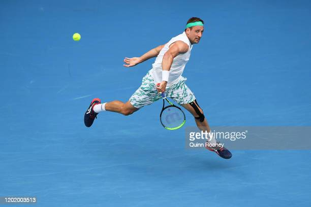 Tennys Sandgren of the United States plays a backhand during his Men's Singles fourth round match against Fabio Fognini of Italy on day seven of the...