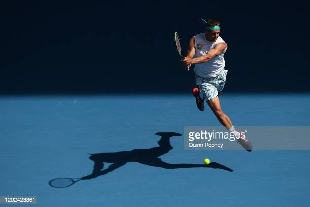 Tennys Sandgren of the United States plays a backhand during his Men's Singles Quarterfinal match against Roger Federer of Switzerland on day nine of...