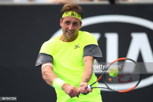 Tennys Sandgren of the United States plays a backhand in his third round match against Maximilian Marterer of Germany on day six of the 2018...