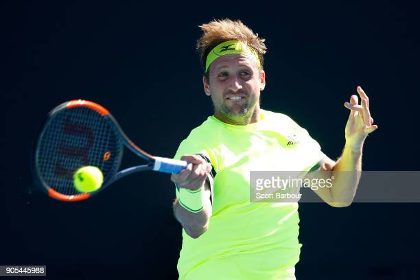 Tennys Sandgren of the United States plays a forehand in his first round match against Jeremy Chardy of France on day two of the 2018 Australian Open...