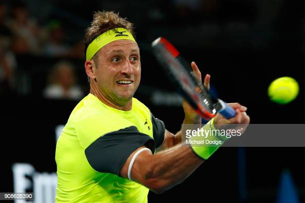 Tennys Sandgren of the United States plays a forehand in his fourth round match against Dominic Thiem of Austria on day eight of the 2018 Australian...
