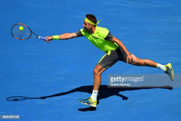 Tennys Sandgren of the United States plays a forehand in his quarter-final match against Hyeon Chung of South Korea on day 10 of the 2018 Australian...