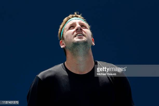 Tennys Sandgren of the United States reacts during his match against Alexander Bublik of Kazakhstan during Day 4 of the Miami Open Presented by Itau...