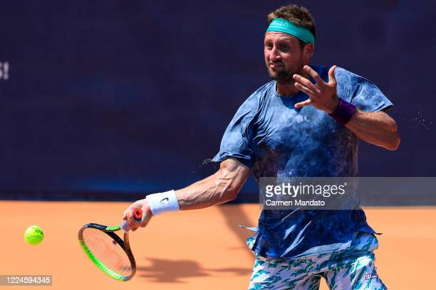 Tennys Sandgren of the United States returns a ball during the singles match against Tommy Paul during the DraftKings All-American Team Cup on July...
