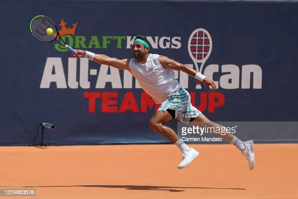 Tennys Sandgren of the United States returns a ball during the singles match against Christopher Eubanks of the United States during the DraftKings...