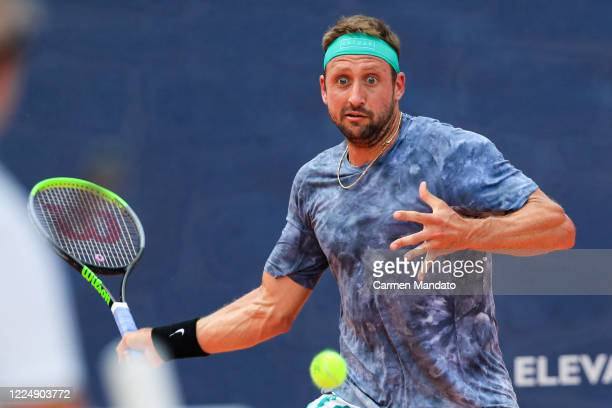 Tennys Sandgren of the United States returns a ball during the singles match against Taylor Fritz of the United States during the final day of the...
