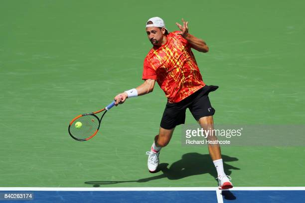 Tennys Sandgren of the United States returns a shot during his first round Men's Singles match against Marin Cilic of Croatia on Day One of the 2017...