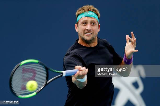 Tennys Sandgren of the United States returns a shot to Alexander Bublik of Kazakhstan during Day 4 of the Miami Open Presented by Itau at Hard Rock...