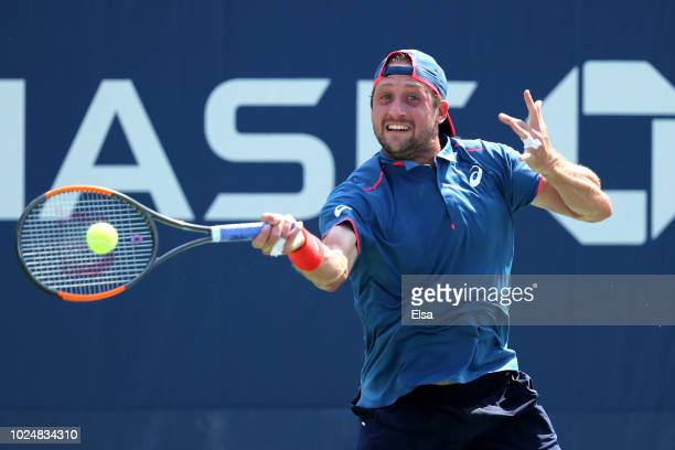 Tennys Sandgren of the United States returns the ball during his men's singles first round match against Viktor Troicki of Serbia on Day Two of the...