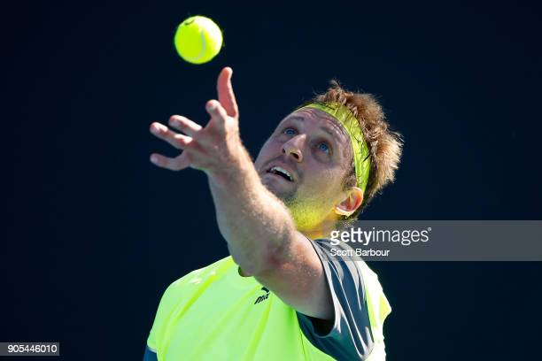 Tennys Sandgren of the United States serves in his first round match against Jeremy Chardy of France on day two of the 2018 Australian Open at...