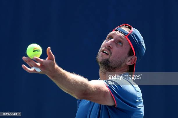 Tennys Sandgren of the United States serves the ball during his men's singles first round match against Viktor Troicki of Serbia on Day Two of the...