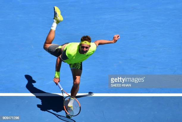 TOPSHOT Tennys Sandgren of the US hits a return against South Korea's Hyeon Chung during their men's singles quarterfinals match on day 10 of the...