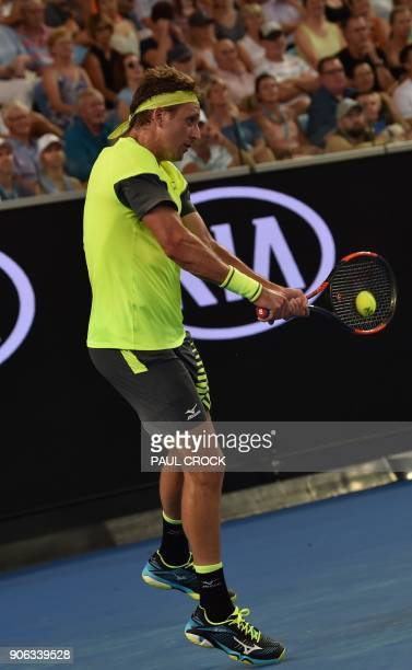 Tennys Sandgren of the US plays a backhand return to Switzerland's Stanislas Wawrinka during their men's singles second round match on day four of...