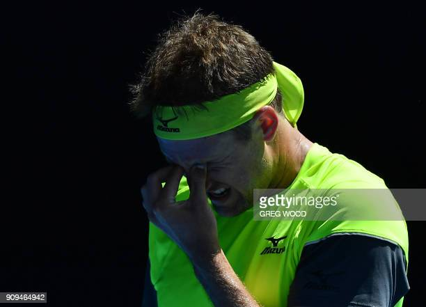 TOPSHOT Tennys Sandgren of the US reacts to a point against South Korea's Hyeon Chung during their men's singles quarterfinals match on day 10 of the...