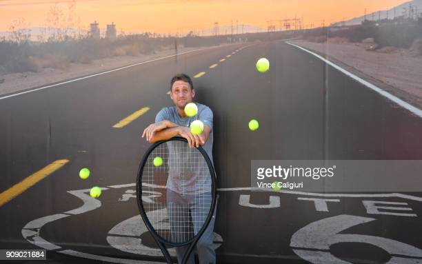 Tennys Sandgren of United States poses at the route 66 sign in garden square during day nine of the 2018 Australian Open at Melbourne Park on January...