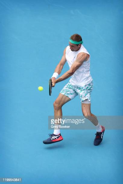 Tennys Sandgren of USA plays a backhand against John Isner of USA during day three of the 2020 Men's ASB Classic at ASB Tennis Centre on January 15,...