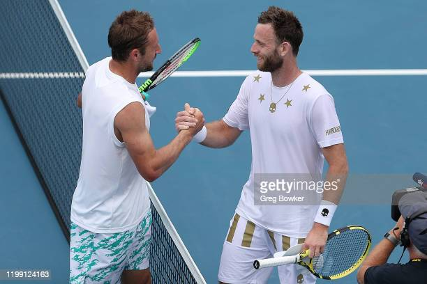 Tennys Sandgren of USA shakes hands with Michael Venus of New Zealand after his win during day one of the 2020 Men's ASB Classic at ASB Tennis Centre...