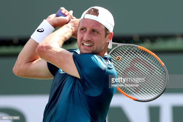 Tennys Sandgren returns a shot to David Ferrer of Spain during the BNP Paribas Open at the Indian Wells Tennis Garden on March 11 2018 in Indian...