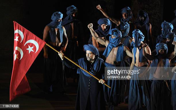 Tenor Carlo Ventre playing the role of Radames performs during the rehearsal of Italian Giuseppe Verdi opera 'Aida' on July 7 in Orange southern...