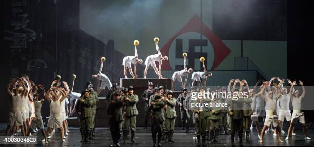 Tenor Charles Castronovo portraying Faust and the ensemble perform on stage during a photocall of 'La damnation de Faust' directed by Terry Gilliam...