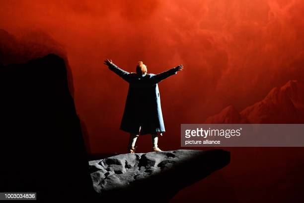 Tenor Charles Castronovo portraying Faust performs on stage during a photocall of 'La damnation de Faust' directed by Terry Gilliam in BerlinGermany...