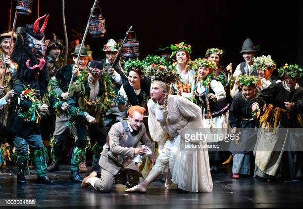 Tenor Charles Castronovo portraying Faust performs on stage during a photocall of 'La damnation de Faust' directed by Terry Gilliam at the Schiller...