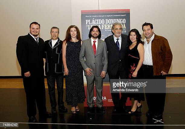 Tenor David Lomeli Emilio Sagi Nino Sanikidze Antonio Gandia Placido Domingo Karen Vuong and Valeriano Lanchas pose together after Domingo introduced...