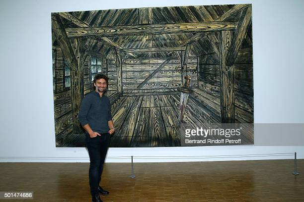 Tenor Jonas Kaufmann poses in front of the 'Notung' work during the Anselm Kiefer's Exhibition Press Preview held at Centre Pompidou on December 15...
