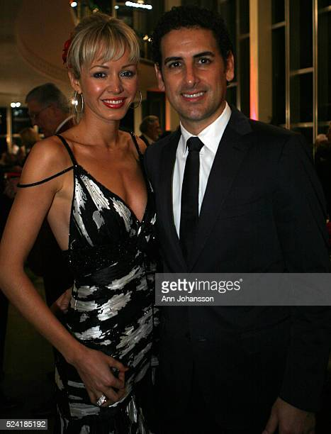 Tenor Juan Diego Flores, right, pose for photographs with his wife Julia at the Hispanics for the LA Opera/Placido Domingo Awards dinner where Flores...