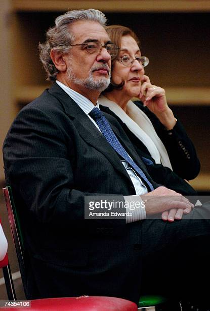 Tenor Placido Domingo and his wife Marta listen to a musical sampling of the LA Opera's first ever Zarzuela a performance with Spanish lyrics which...