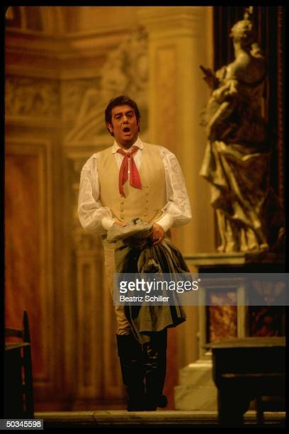 Tenor Placido Domingo singing the role of Cavaradossi in Puccini's Tosca on stage at the Metropolitan Opera.