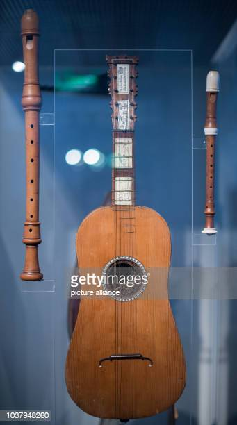 A tenor recorder a guitar and a descant recorder can be seen in the exhibition 'Pomposa Violins for Bach The Hoffmann Workshop in Leipzig' in the...