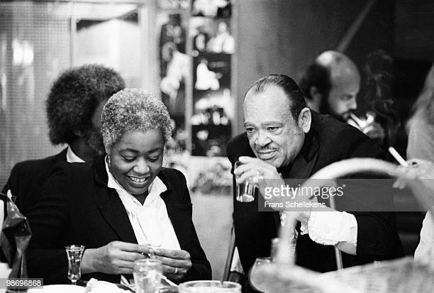 Tenor Sax player Arnett Cobb drinks backstage with Mary Little at Vredenburg in Utrecht, Holland on May 02 1982. Behind Mary is her husband Wilbur...