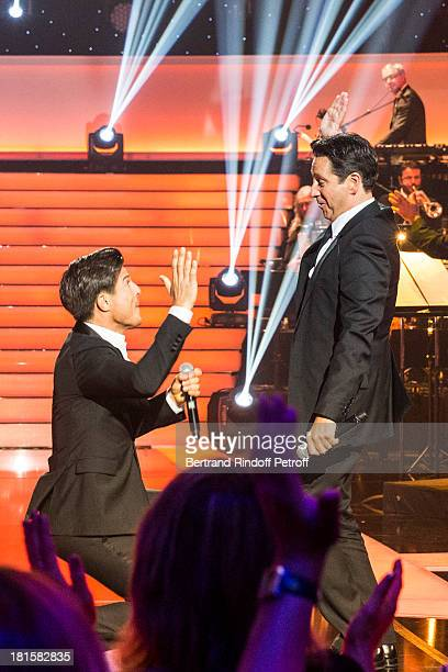 Tenor singer Vincent Niclo and impersonator Laurent Gerra impersonating late tenor singer Luis Mariano perform during the live broadcast on public...