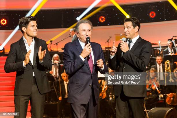 Tenor singer Vincent Niclo show host Michel Drucker and impersonator Laurent Gerra who impersonated late tenor singer Luis Mariano acknowledge...