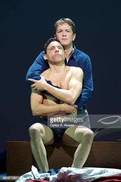 Tenor Tom Randle and bassbaritone Daniel Okulitch perform on stage during a press preview of the Brokeback Mountain Opera at the Teatro Real on...