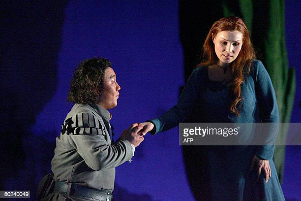 Tenor Woo Kyung Kim playing the role of Faust and Maira Kerey playing Marguerite perform during the rehearsal of the opera 'Faust' by Charles Gounod...