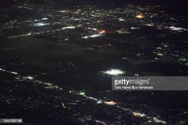 Tenri and Yamatokoriyama cities, and Tawaramoto town in Nara prefecture in Japan night time aerial view from airplane